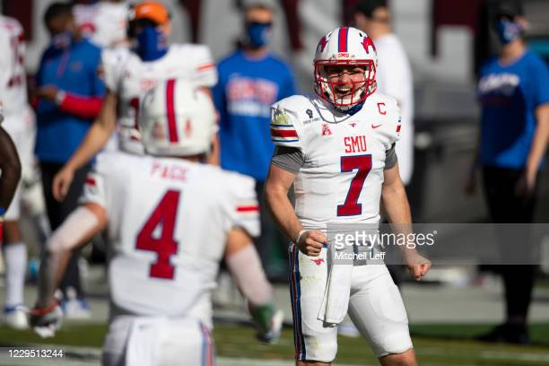 Shane Buechele of the Southern Methodist Mustangs reacts after throwing a touchdown pass to Tyler Page against the Temple Owls in the first quarter...