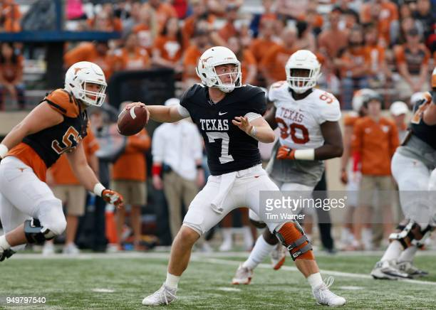 Shane Buechele of the Texas Longhorns looks to pass in the first half during the OrangeWhite Spring Game at Darrell K RoyalTexas Memorial Stadium on...