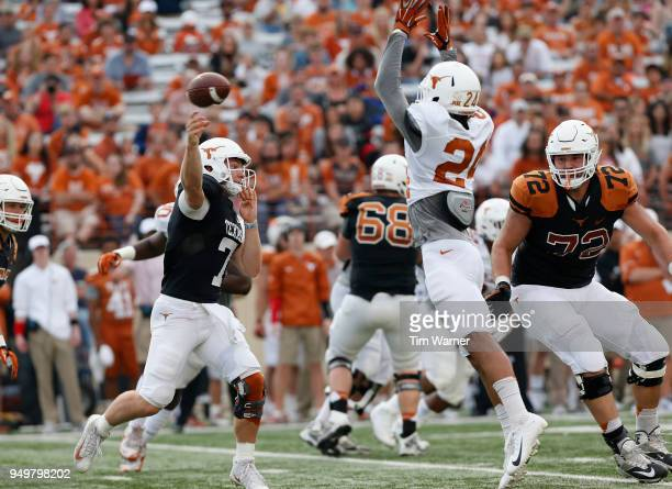 Shane Buechele of the Texas Longhorns throws a pass under pressure by John Bonney in the first half during the OrangeWhite Spring Game at Darrell K...