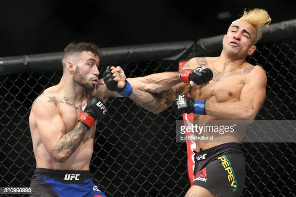 Shane Burgos lands a left hand on Godofredo Pepey during their UFC Fight Night featherweight bout at the Nassau Veterans Memorial Coliseum on July 22...