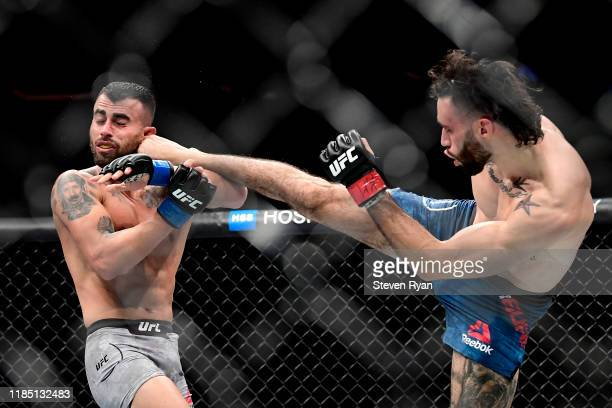Shane Burgos of the United States kicks Makwan Amirkhani of Finland in the Light Heavyweight bout during UFC 244 at Madison Square Garden on November...