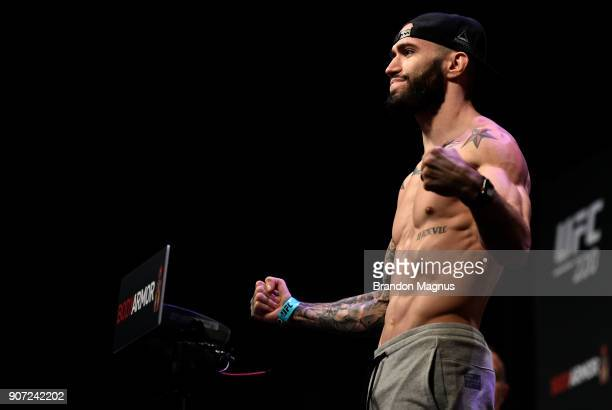 Shane Burgos poses on the scale during the UFC 220 weighin at TD Garden on January 19 2018 in Boston Massachusetts