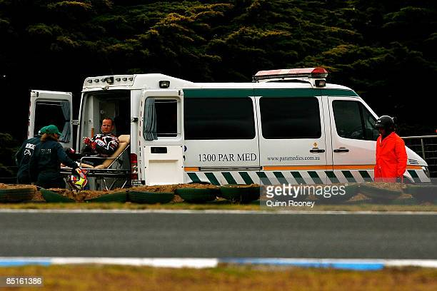 Shane Byrne of Great Britian and Team Sterilgarda is loaded into an ambulance after crashing during race one for round one of the Superbike World...