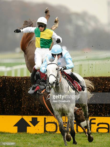 Shane Byrne riding Stagecoach Pearl jump the last to win The Follow Paul Nicholls On Facebook And Twitter Handicap Steeple Chase as Richard Johnson...