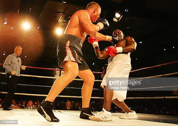 Shane Cameron of New Zealand punches Friday Ahunanya of the USA during the WBO Asia Pacific Title Fight at the SKYCITY Convention Centre November 2,...