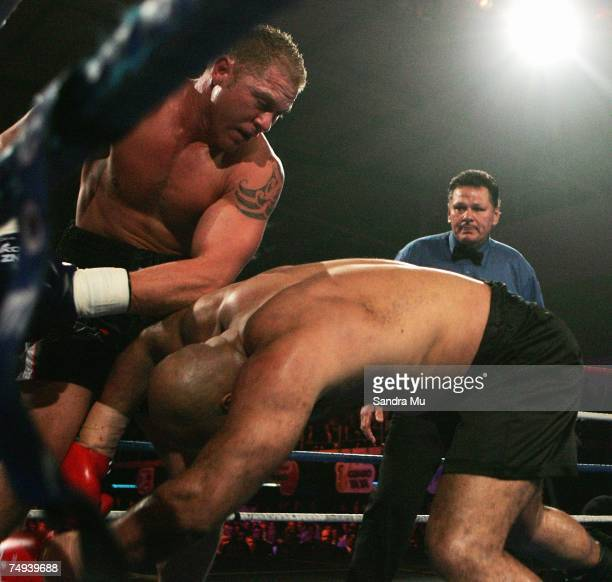 Shane Cameron of New Zealand punches Jucimar Francisco Hipolito of Brazil through the ropes during the IBF Pan Pacific Heavyweight, WBA Pan African...