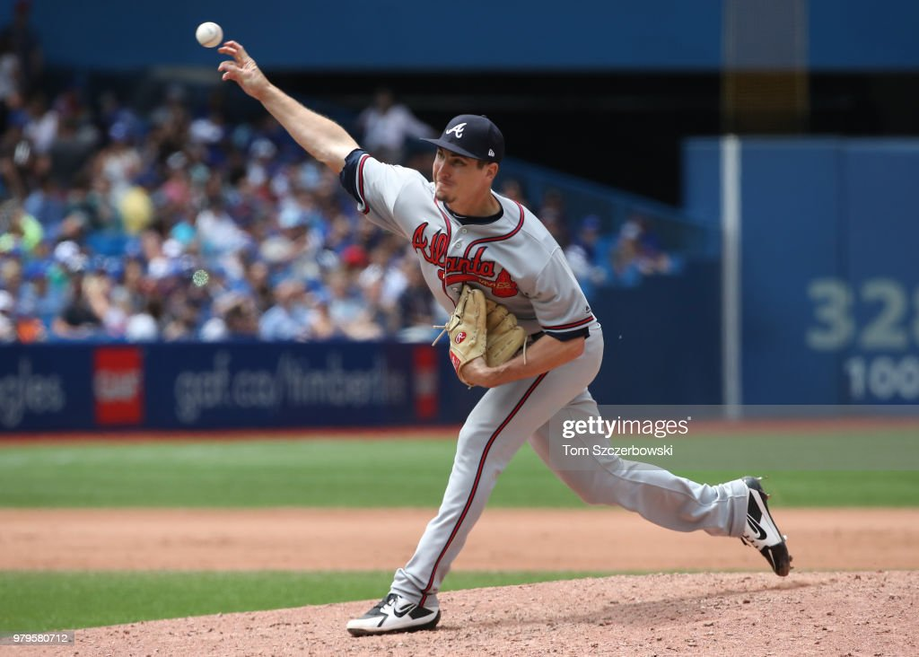 Shane Carle #51 of the Atlanta Braves delivers a pitch in the seventh inning during MLB game action against the Toronto Blue Jays at Rogers Centre on June 20, 2018 in Toronto, Canada.