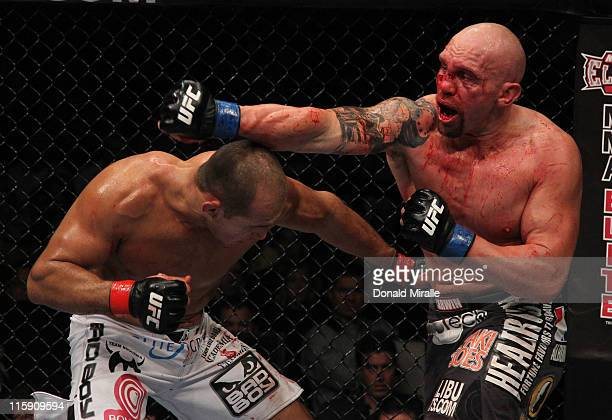 Shane Carwin punches Junior Dos Santos during a heavyweight bout at UFC 131 at Rogers Arena on June 11 2011 in Vancouver British Columbia Canada