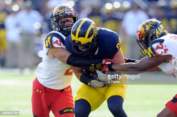 Shane Cockerille of the Maryland Terrapins tackles Jake Butt of the Michigan Wolverines at Michigan Stadium on November 5 2016 in Ann Arbor Michigan