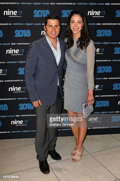 Shane Crawford and Giaan Rooney pose as they arrive at the Nine 2013 program launch at Myer on November 28 2012 in Melbourne Australia
