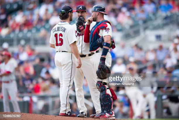 Shane Culbertson Shane Carle and Tyler Flowers of the Atlanta Braves meet at the mound during the ninth inning against the Philadelphia Phillies at...