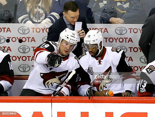 Shane Doan and Anthony Duclair of the Arizona Coyotes discuss strategy on the bench during second period action against the Winnipeg Jets at the MTS...
