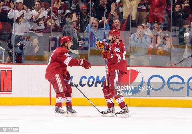 Shane Doan celebrates with Wojtek Wolski of the Phoenix Coyotes after Wolski scored the gamewinning goal against the Colorado Avalanche on March 4...