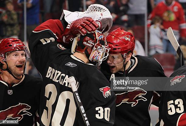 Shane Doan Ilya Bryzgalov#30 and Zbynek Michalek of the Phoenix Coyotes celebrate after winning the NHL game against the Chicago Blackhawks at...
