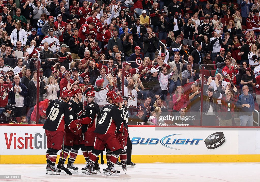Shane Doan #19, Michael Stone #29, Keith Yandle #3 and Matthew Lombardi #8 of the Phoenix Coyotes celebrate after Lombardi scored a third period goal against the Anaheim Ducks during the NHL game at Jobing.com Arena on March 4, 2013 in Glendale, Arizona. The Coyotes defeated the Ducks 5-4 in an overtime shootout.