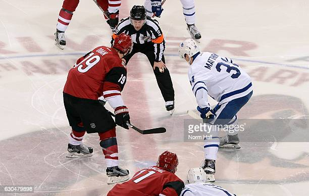 Shane Doan of the Arizona Coyotes and Auston Matthews of the Toronto Maple Leafs prepare to take the opening faceoff from referee Kyle Rehman at Gila...