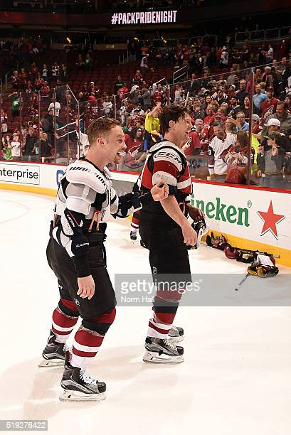 Shane Doan of the Arizona Coyotes and teammate Max Domi skate off the ice after giving their jerseys away for fan appreciation night after a game...