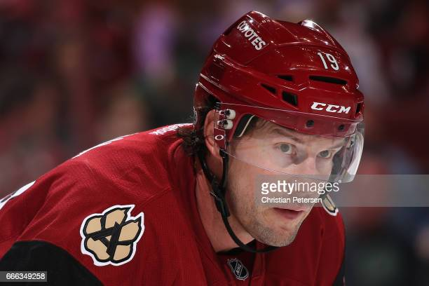 Shane Doan of the Arizona Coyotes awaits a face off during the second period of the NHL game against the Minnesota Wild at Gila River Arena on April...