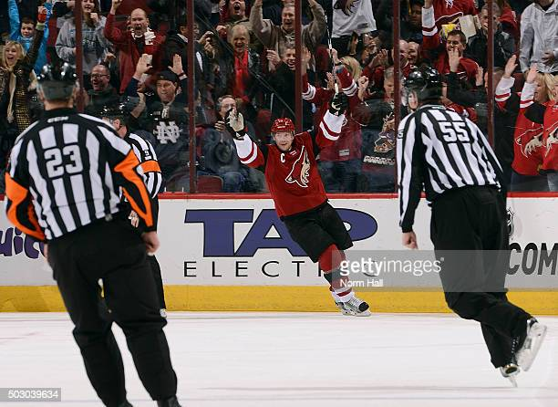 Shane Doan of the Arizona Coyotes celebrates his first period goal against the Winnipeg Jets at Gila River Arena on December 31 2015 in Glendale...