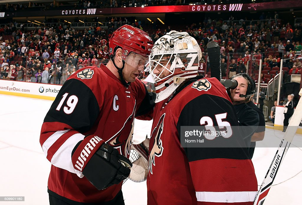 Shane Doan #19 of the Arizona Coyotes celebrates with teammate Louis Domingue #35 after a 4-1 victory against the Calgary Flames at Gila River Arena on February 12, 2016 in Glendale, Arizona. Doan had two goals and an assist in the game which made him the all time franchise leader in points and power play goals.