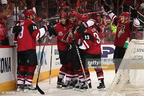 Shane Doan of the Arizona Coyotes celebrates with teammates Brendan Perlini Dylan Strome Anthony Duclair Alex Goligoski and Jakob Chychrun after Doan...