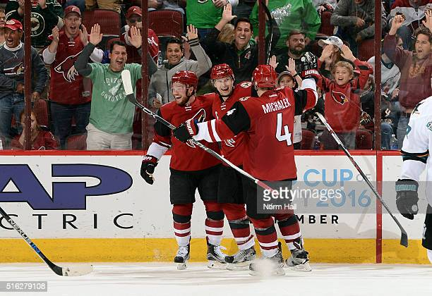 Shane Doan of the Arizona Coyotes celebrates with teammates Max Domi and Zbynek Michalek after his third period goal against the San Jose Sharks at...