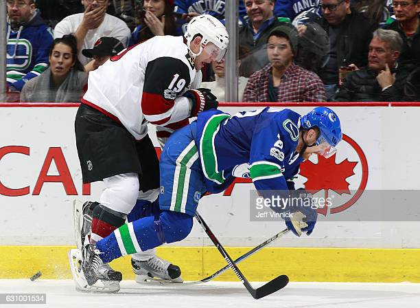 Shane Doan of the Arizona Coyotes checks Daniel Sedin of the Vancouver Canucks during their NHL game at Rogers Arena January 4 2017 in Vancouver...