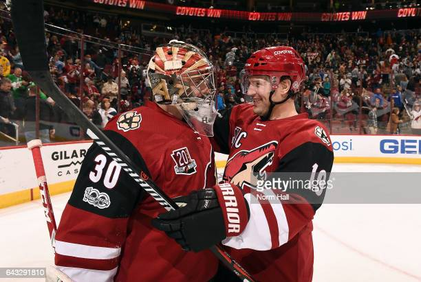 Shane Doan of the Arizona Coyotes congratulates teammate Marek Langhamer after a 32 victory against the Anaheim Ducks at Gila River Arena on February...