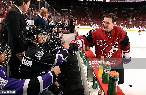 Shane Doan of the Arizona Coyotes greets youth hockey players before a game against the Columbus Blue Jackets at Gila River Arena on December 3 2016...