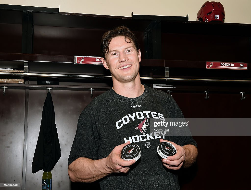 Shane Doan #19 of the Arizona Coyotes holds the record breaking pucks from his game against the Calgary Flames at Gila River Arena on February 12, 2016 in Glendale, Arizona. Doan had two goals and an assist which made him the all time franchise leader in points and power play goals.