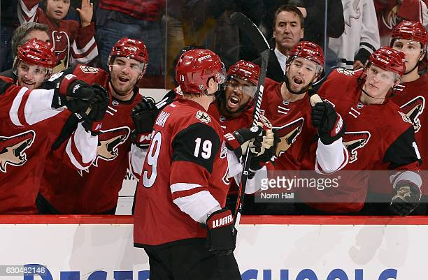 Shane Doan of the Arizona Coyotes is congratulated by teammates after scoring his 400th career NHL goal during the second period against the Toronto...