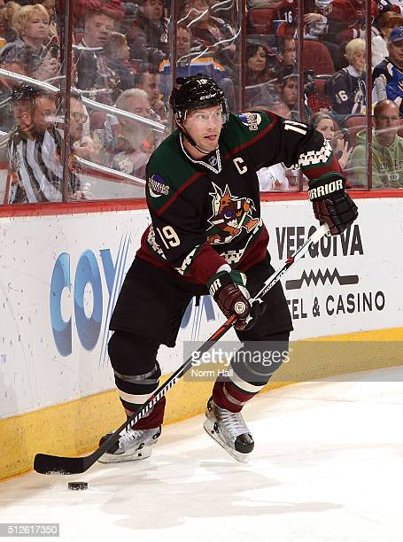 Shane Doan of the Arizona Coyotes looks to pass the puck up ice against the St Louis Blues at Gila River Arena on February 20 2016 in Glendale Arizona