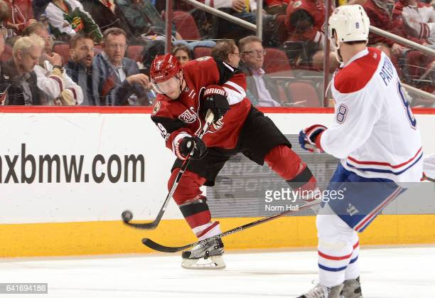 Shane Doan of the Arizona Coyotes passes the puck past Greg Pateryn of the Montreal Canadiens at Gila River Arena on February 9 2017 in Glendale...