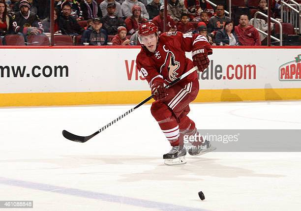 Shane Doan of the Arizona Coyotes passes the puck up ice against the Columbus Blue Jackets at Gila River Arena on January 3 2015 in Glendale Arizona