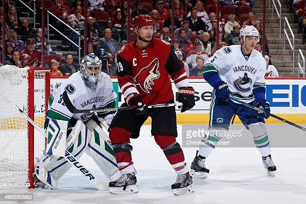 Shane Doan of the Arizona Coyotes sets up in front of goaltender Richard Bachman of the Vancouver Canucks during the NHL game at Gila River Arena on...