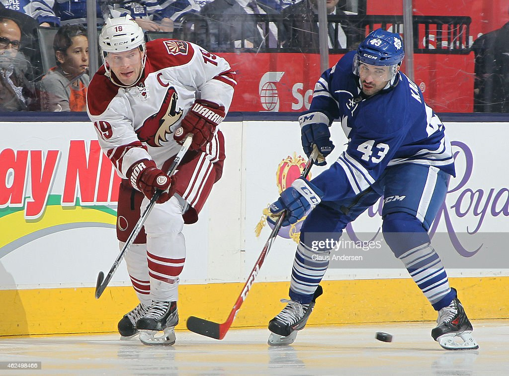 Shane Doan #19 of the Arizona Coyotes skates against Nazem Kadri #43 of the Toronto Maple Leafs during an NHL game at the Air Canada Centre on January 29, 2015 in Toronto, Ontario, Canada. The Coyotes defeated the Leafs 3-1.
