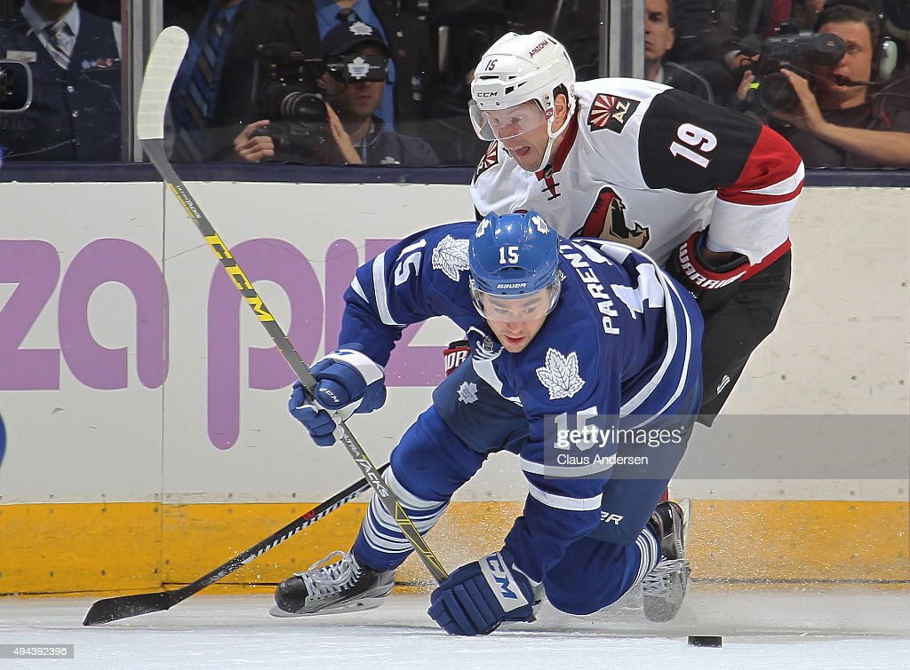 Shane Doan #19 of the Arizona Coyotes skates against PA Parenteau #15 of the Toronto Maple Leafs during an NHL game at the Air Canada Centre on October 26, 2015 in Toronto, Ontario, Canada. The Coyotes defeated the Leafs 4-3.
