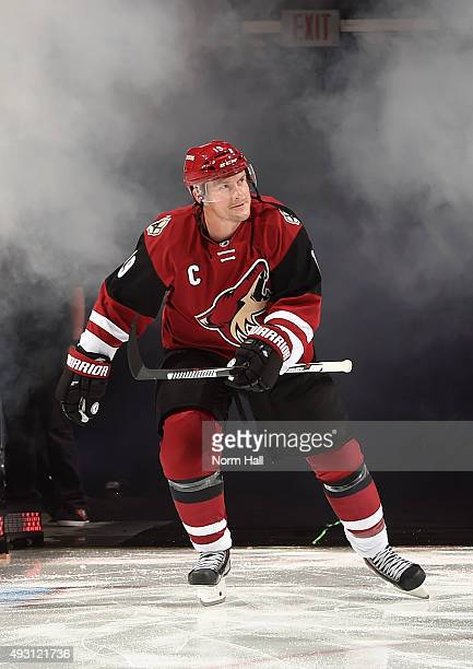 Shane Doan of the Arizona Coyotes skates onto the ice during pregame ceremonies prior to a game against the Pittsburgh Penguins at Gila River Arena...