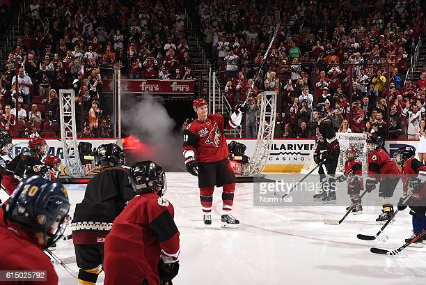 Shane Doan of the Arizona Coyotes skates onto the ice during pregame introductions against the Philadelphia Flyers at Gila River Arena on October 15...