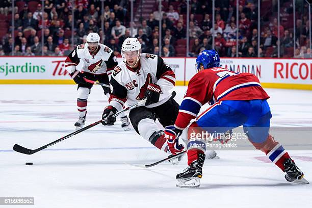 Shane Doan of the Arizona Coyotes skates the puck against Alexei Emelin of the Montreal Canadiens during the NHL game at the Bell Centre on October...
