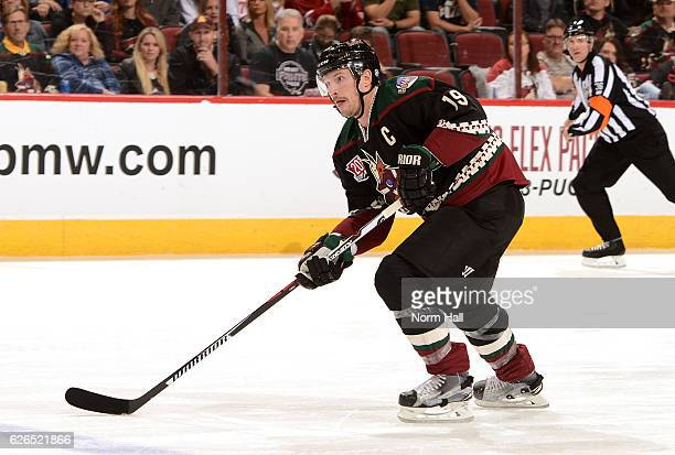 Shane Doan of the Arizona Coyotes skates the puck up ice against the Edmonton Oilers at Gila River Arena on November 25 2016 in Glendale Arizona