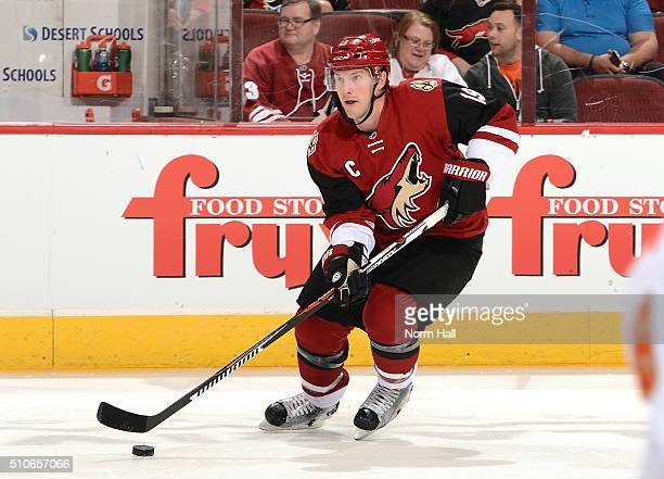 Shane Doan of the Arizona Coyotes skates with the puck against the Calgary Flames at Gila River Arena on February 12 2016 in Glendale Arizona
