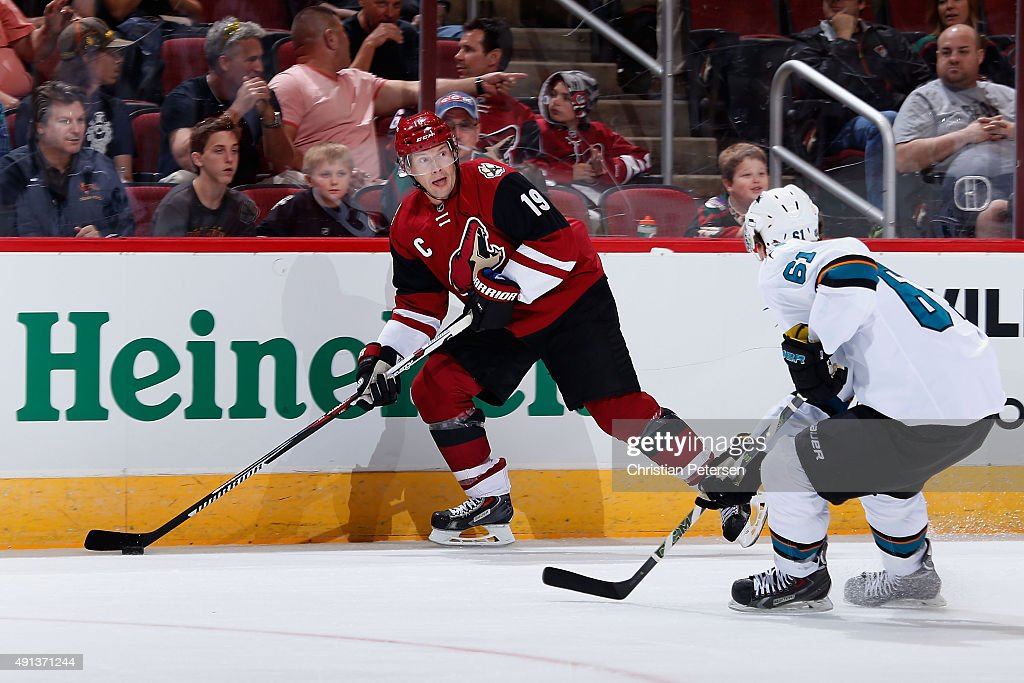 Shane Doan #19 of the Arizona Coyotes skates with the puck during the NHL preseason game against the San Jose Sharks at Gila River Arena on October 2, 2015 in Glendale, Arizona.