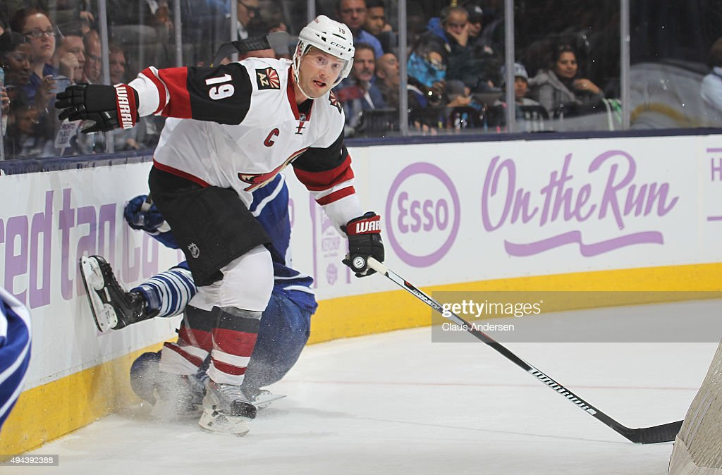 Shane Doan #19 of the Arizona Coyotes slams into Morgan Rielly #44 of the Toronto Maple Leafs during an NHL game at the Air Canada Centre on October 26, 2015 in Toronto, Ontario, Canada. The Coyotes defeated the Leafs 4-3.