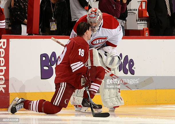 Shane Doan of the Arizona Coyotes talks with Carey Price of the Montreal Canadiens during pregame skate at Gila River Arena on March 7 2015 in...