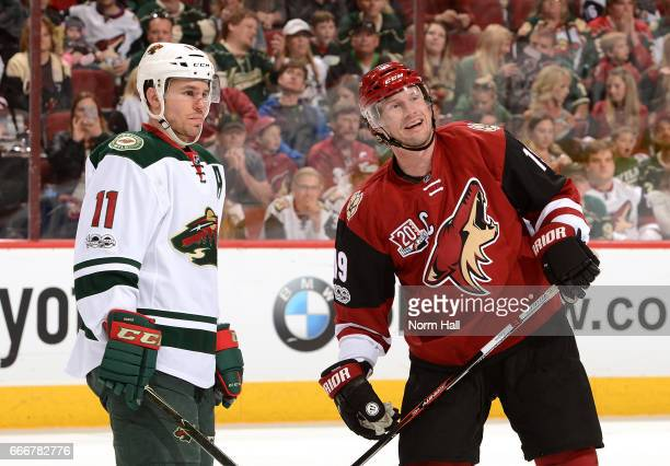 Shane Doan of the Arizona Coyotes talks with Zach Parise of the Minnesota Wild during a game at Gila River Arena on April 8 2017 in Glendale Arizona
