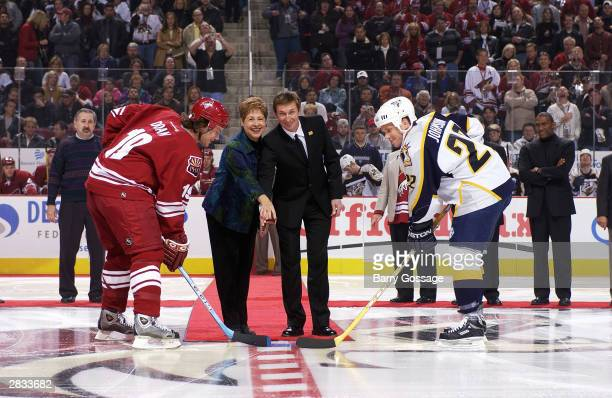 Shane Doan of the Phoenix Coyotes and Greg Johnson of the Nashville Predators take the ceremonial puck drop from Glendale Arizona Mayor Elaine...