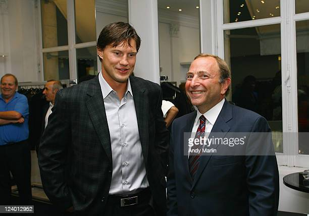 Shane Doan of the Phoenix Coyotes and NHL Commissioner Gary Bettman chat during the cocktail reception hosted by Versace for the stars of the...