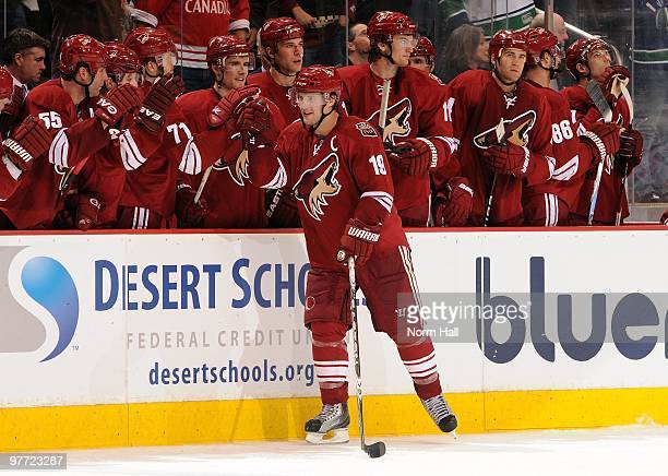 Shane Doan of the Phoenix Coyotes celebrates a goal against the Vancouver Canucks with teammates on March 10 2010 at Jobingcom Arena in Glendale...