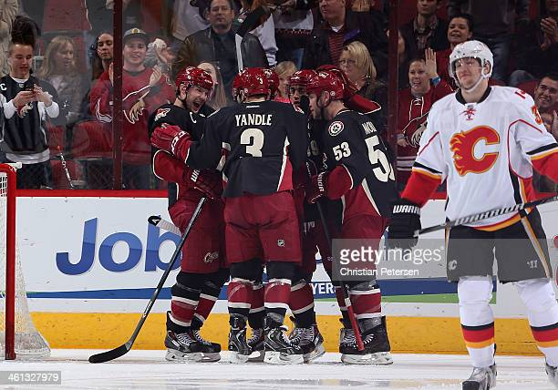 Shane Doan of the Phoenix Coyotes celebrates with Keith Yandle Mike Ribeiro and Derek Morris after scoring a second period goal against the Calgary...